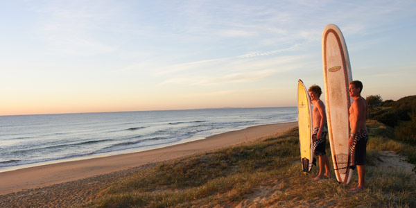 Mark-surfers-at-sunrise